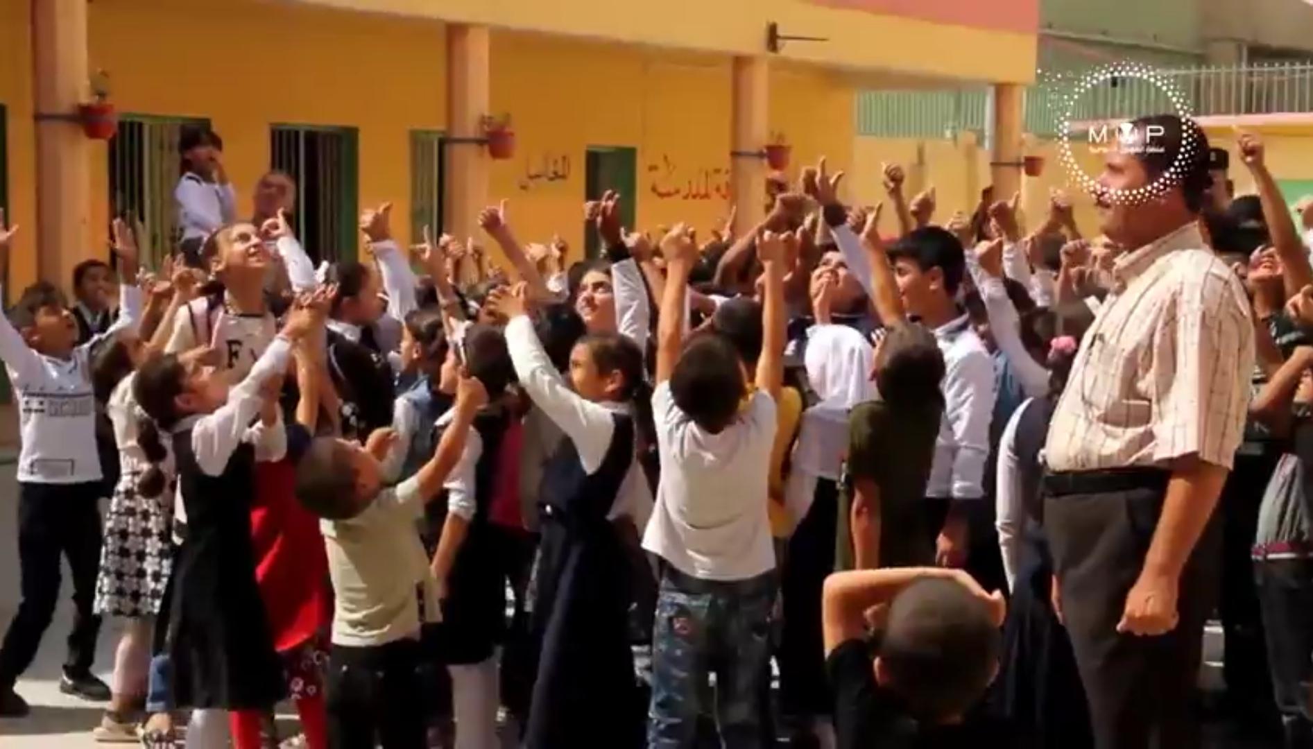 صورة عودة الطلبة الى مدارس الموصل